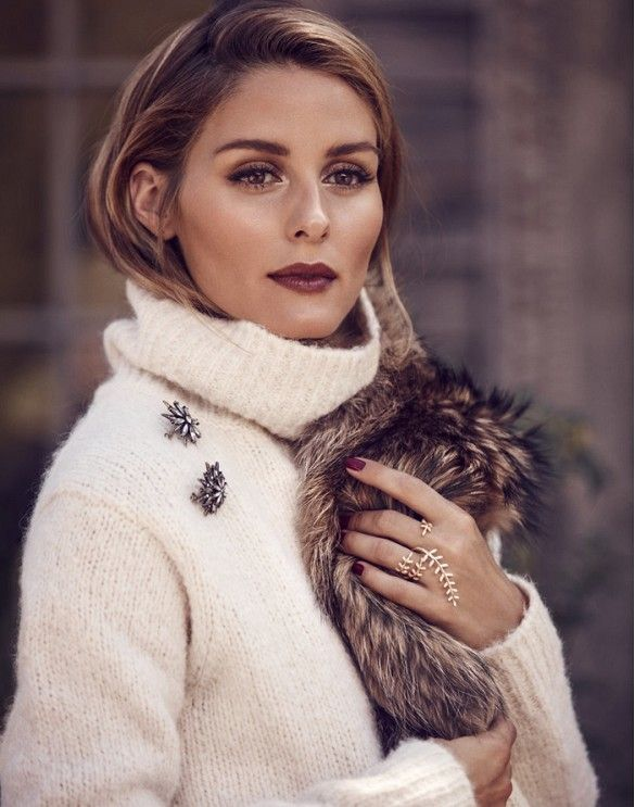 Olivia Palermo wears an ivory turtleneck with a Baublebar North Star brooch set.