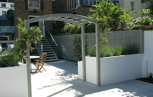 white rendered garden walls with fence and arbour in a soft grey green - The Garden Trellis Company | Products | Bespoke Contemporary Slatted Panels