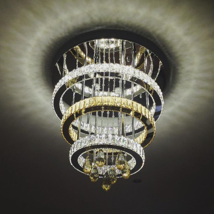 Our customised chandelier creates an elegant focal point to our clients formal dining room.