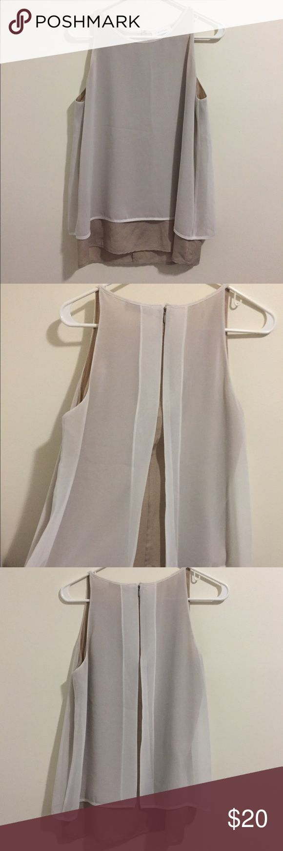 Calvin Klein blouse Calvin Klein blouse with white overlay and beige under-slip. Zip closure in the back. Fits like a small/medium. Calvin Klein Tops Blouses