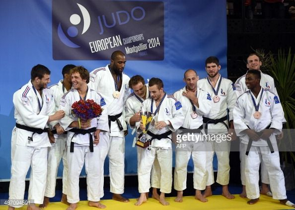 France's judo team members Alexandre Iddir, David Larose , Loic Pietri, Teddy Riner, Ugo Legrand, Vincent Limare, Alain Schmitt, Cyrille Maret, Loic Korval and Romain Buffet celebrate on the podium...