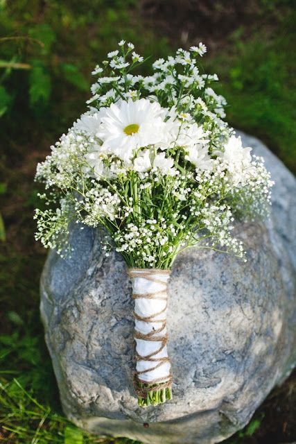 Boho wedding bouquet we love. Baby's Breath and Daisies