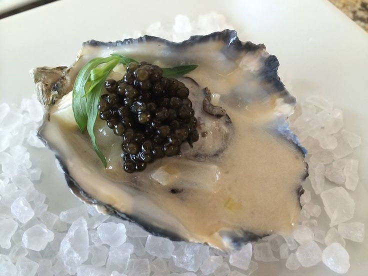 Black River Russian Caviar served on a Marin Bay Oyster lightly poached in a leek, cream, wine reduction sauce.