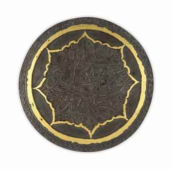 A gold overlaid and endraved steel roundel | Safavid or Zand Iran, circa 18th century
