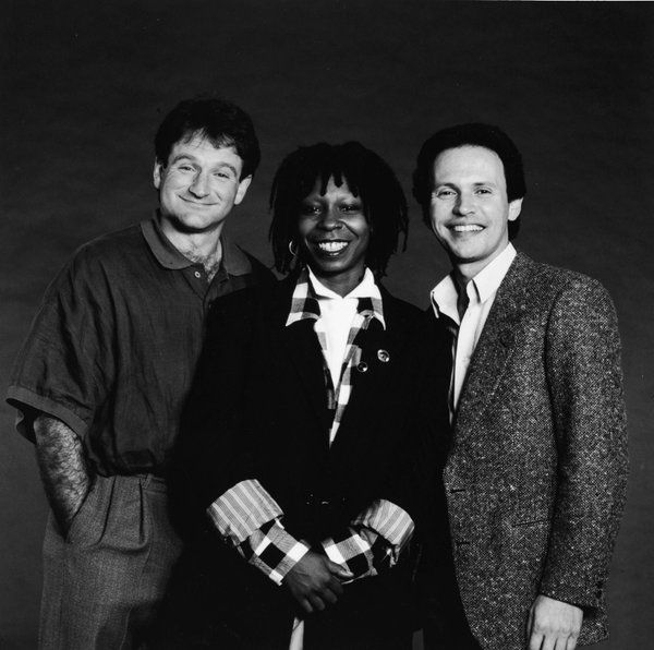 Robin Williams, Whoopi Goldberg, and Billy Crystal in 1986.
