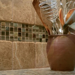 Backsplash idea - i like the smaller tiles centered between large blocks. Maybe use this idea for behind the stove and just regular tile every where else.