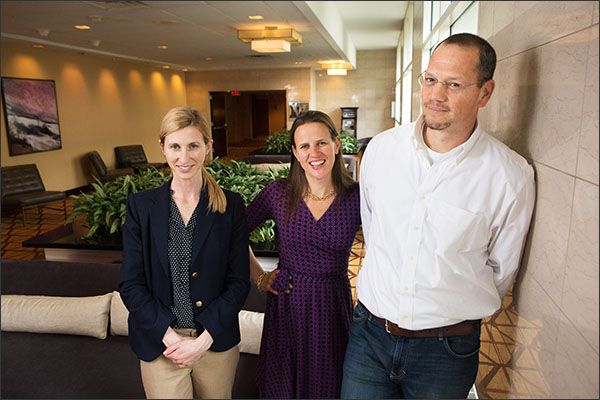 Colleen Driggs, Erica Woolway, and Doug Lemov take a break during a conference last week. The trio distill practical advice and research on teaching reading in a forthcoming book, <i>Reading Reconsidered</i>.