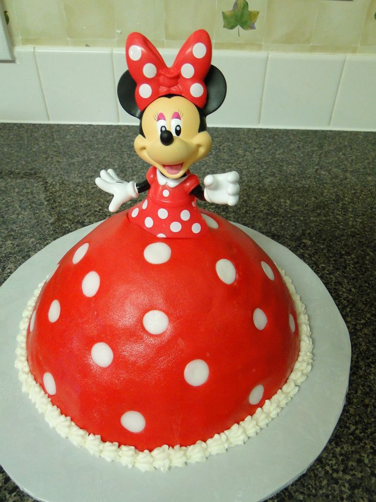 Minnie Mouse doll cake; rolled buttercream with Minnie Mouse licensed doll