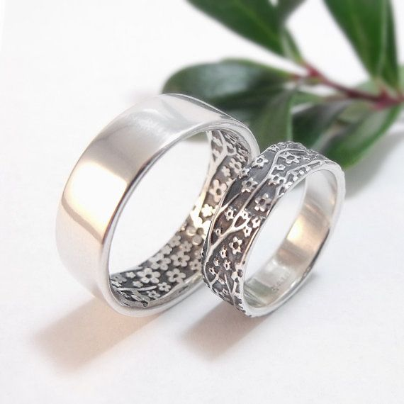 These rings were inspired by a challenge that I often face. One half of a couple prefers a floral pattern and the other wants something more subtle. Although I have several non-floral wedding band styles, most couples want rings that match. So this is a solution to that problem. If the future groom does not want a flowery wedding band he can have what is, to outward appearances, a plain band that matches her band on the inside. These bands feature my cherry blossom pattern. They are…