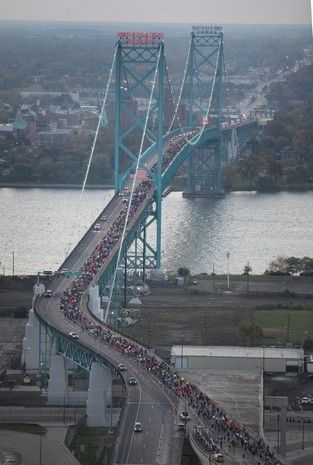 Aerial view of runners crossing the Ambassador Bridge into Canada during the 2013 Detroit Free Press/Talmer Bank Marathon in Detroit.