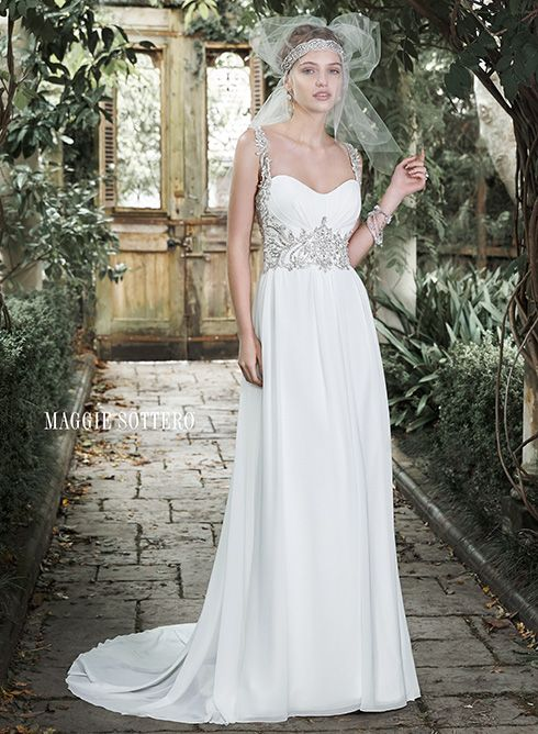 Jeanette Romance is found in this stunning Paris chiffon sheath dress with scoop neckline and sparkling Swarovski crystal embellishment at the waist, tracing over the shoulders and leading to a Swarovski crystal encrusted tank strap and illusion back adorned with crystals. Finished with crystal buttons and zipper closure.Available from Georgina's Bridal Boutique, Kinver, 01384877688