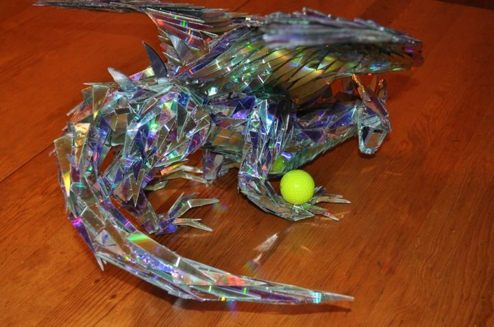 Mythical Dragon Sculpture Made of Shattered CDs by Sean Avery.
