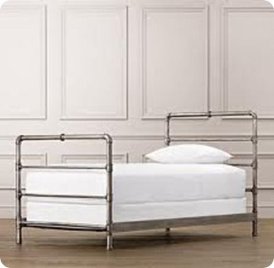 DIY Bed frame made out of pipe.  Love the look of this.  Would be especially durable for chidldren.