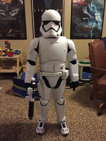If you've been down the toy aisles lately, you've possibly seen the giant First Order stormtrooper toy for sale. It's the size of a small child. Some people have realized the toy can be disassembled and turned into a costume. Replica Props Forum (RPF) user Psicorp7 did just that so his son could be in armor for The Force Awakens premiere. He had friends help remove the tons of screws on the costume with a long-handled Phillips head screwdriver, and then it was a matter of cutting out all the…