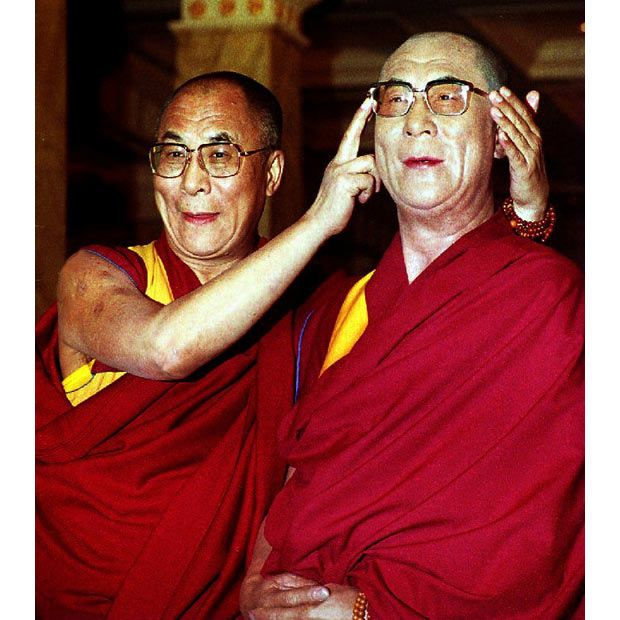1 November 1993: The Dalai Lama poses with his wax portrait in the Grand Hall at Madame Tussaud's in London.