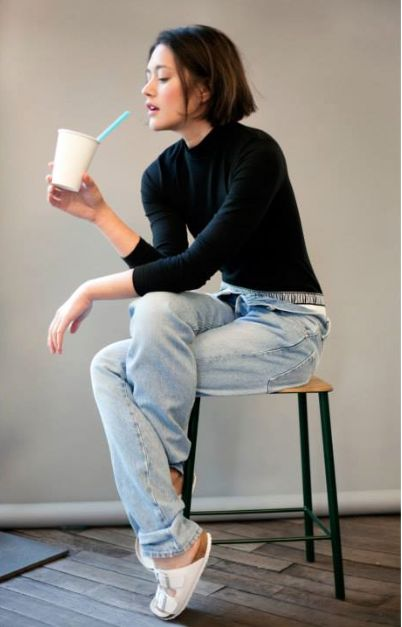 Everything's perfect though: the hair, smoothie, long sleeve shirt, loose 90's jeans… it screams me