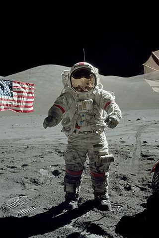 """Astronaut      How can the flag behind him be """"flying"""" if there is no wind on the moon?"""