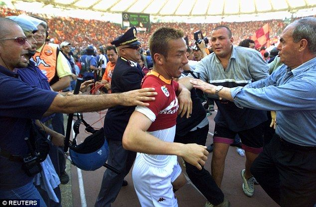 Hidetoshi Nakata is mobbed after Roma won the Scudetto after beating Parma 3-1