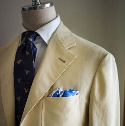 Beige jacket, white shirt, navy tie