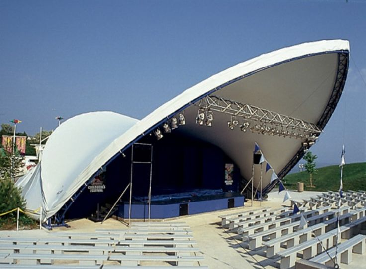 saddlespan tent with lighting, stage, seating and dance floor