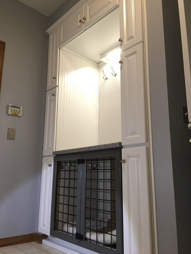 Transform your laundry room closet into a custom built-in dog crate with cabinets for storage.