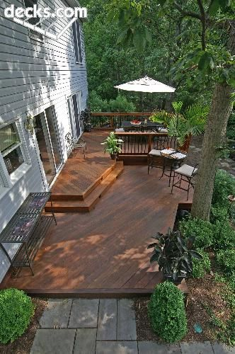 deck- wide steps down from door. gots to have big porches or decks around the cabin.