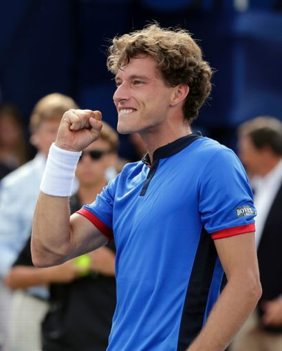 Pablo Carreno Busta, of Spain, celebrates after winning the Winston-Salem Open tennis tournament over Roberto Bautista Agut, also of Spain, in Winston-Salem, N.C., Saturday, Aug. 27, 2016. (AP Photo/Chuck Burton)