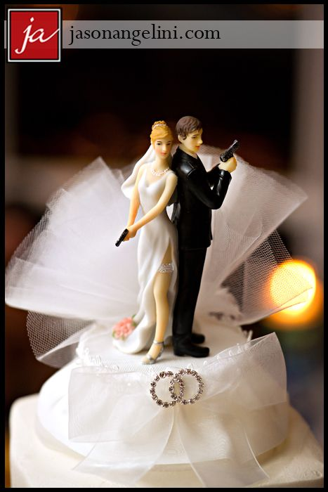 Fun Wedding cake topper with guns!!