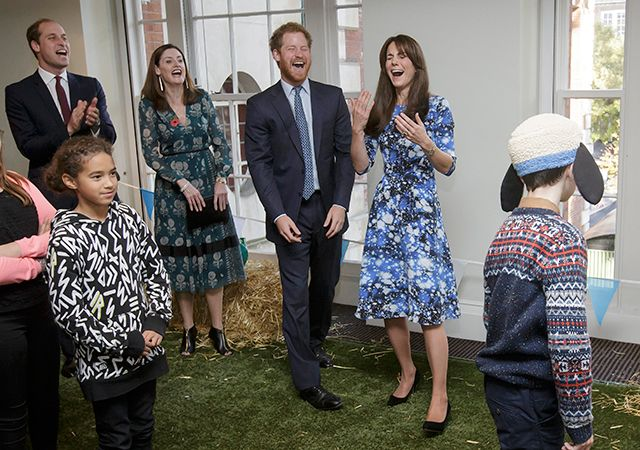Kate Middleton Is Adorable -- and Can't Stop Smiling -- With William and Harry at Kids' Charity Event
