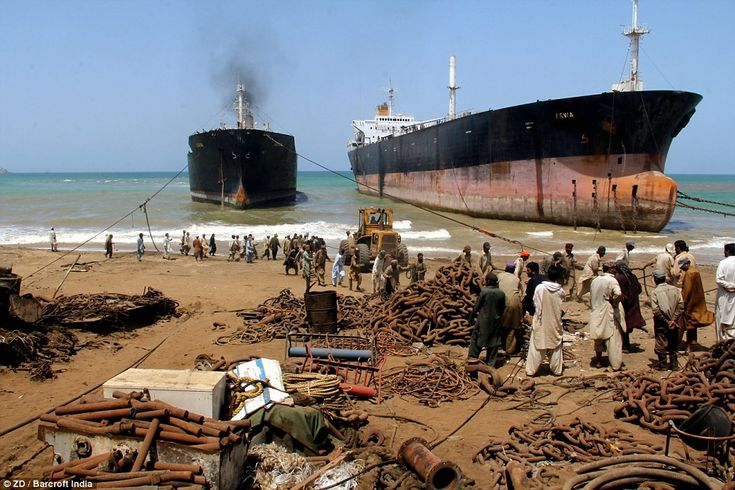 End of the line: Two huge tankers are hauled onto the sandy shore at Gadani in Pakistan where they will be broken up and sold for scrap.