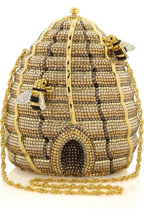 Yellow, brown, topaz and gold hand-painted and crystal-embellished beehive-shaped clutch with gold-tone hardware and trim. Judith Leiber clutch has bee details, a chain handle that can be hidden inside the bag, push-lock closure at top, a hinge at base, is lined in gold leather and comes with a small designer-engraved vanity mirror.