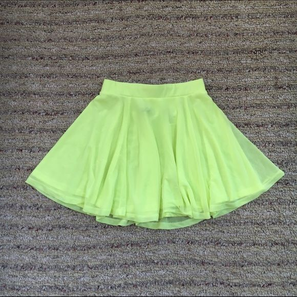 Neon Yellow Skater Skirt Neon yellow skater skirt!!! Super cute and fashionable! It's a little sheer but not too bad! In awesome condition!! Only worn one time! Tag says size 4 but fits more like a 0/2 H&M Skirts Circle & Skater