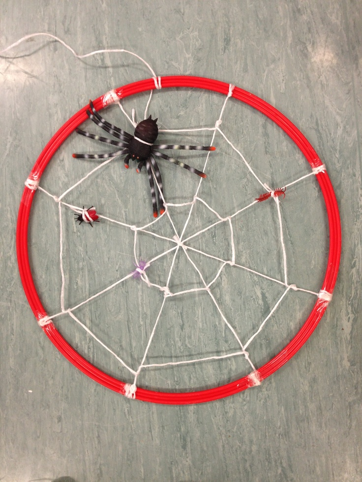 Spiders web around a hoop. Minibeast activities.