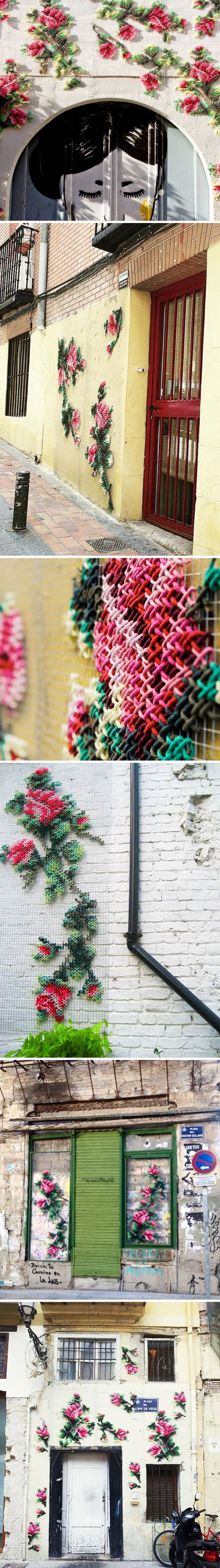 What!? Urban cross-stitching… oh my word. This is the work of artist/set designer Raquel Rodrigo. Wire mesh and some very colorful rope working together to create lovely gardens on the walls around Ma