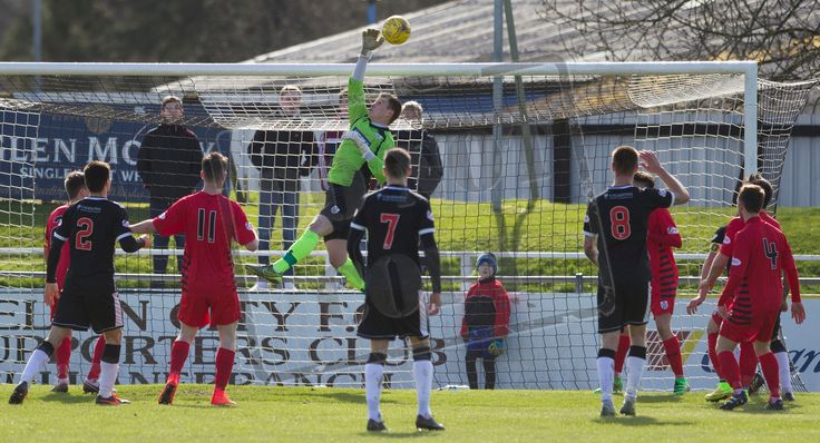 Queen's Park's keeper Wullie Muir deals with the cross during the SPFL League Two game between Elgin City and Queen's Park.