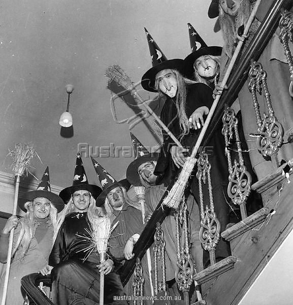 STAIRCASE OF WITCHES A Group Of Men In Costume As Witches Complete With Brooms To Celebrate Halloween Lined The Staircase House Photo By George
