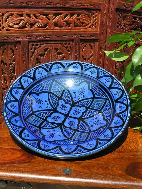 Large plate in a traditional Moroccan blue pattern. http://www.maroque.co.uk/showitem.aspx?id=ENT00800&p=00739&n=all