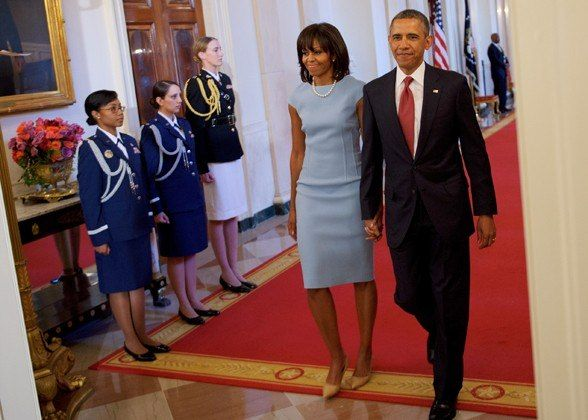 In Michael Kors, and with the President on her arm, arriving at a medal of honor presentation ceremony at the White House.