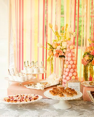 Love the curtain of ribbons - it's unique and colorful...consider for the sweetheart table backdrop?  but with black and white and/or flocked damask ribbons???  I just bought a bunch of ribbons from Costco...I may do a test run...