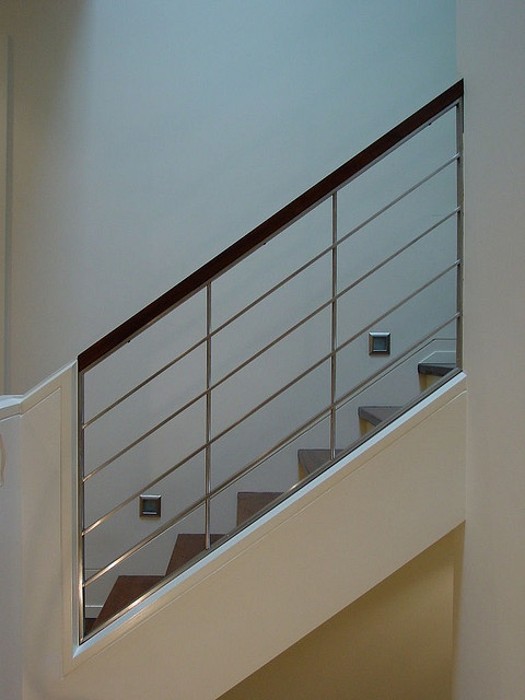 residential staircase banister by Serious Stainless, Toronto
