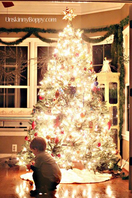 """How to take awesome pictures of lighted things (like a christmas tree). """"We gave this tip last year, but it's worth repeating! Turn off your flash, along with all the other lights in your house, crank up your ISO, use your tripod, and meter on the light from the tree."""""""
