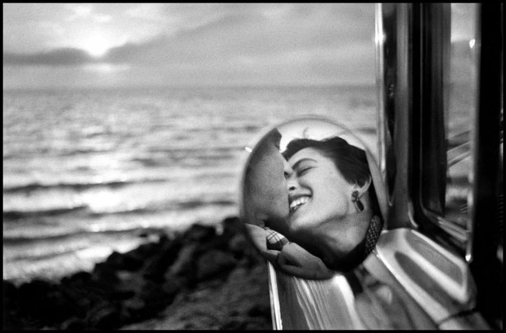 "Elliott Erwitt's Very Own Personal Best: California, 1955. ""This was a picture that I didn't know I had until 25 years after I took it...and it become a popular photo for galleries and exhibitions. It's at the end of Route 66 in Santa Monica or Pacific Palisades. It was kind of a place where you went to look at the sunset and muck about."""
