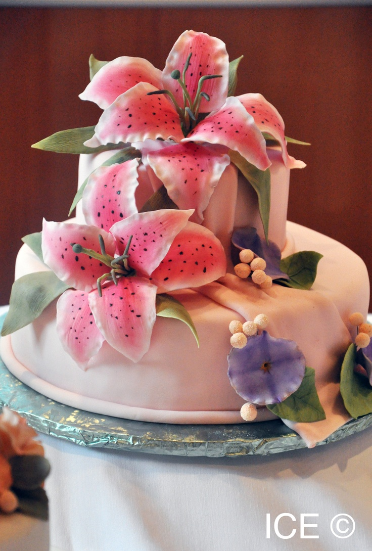 111 best flower making images on pinterest gum paste flowers a cake with pink lilly flowers dhlflorist Image collections