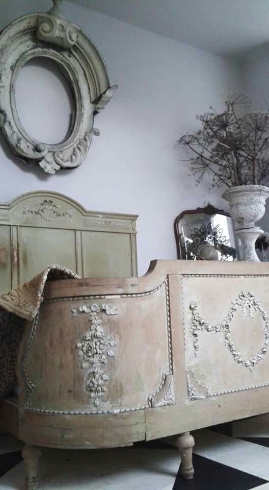 Pretty French style bed decorated with carved wooden appliques. You can find similar wood appliques online at www.buycarvings.co.uk