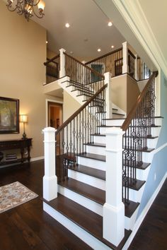 Open railing stairs with wrought iron balusters avbinc.com