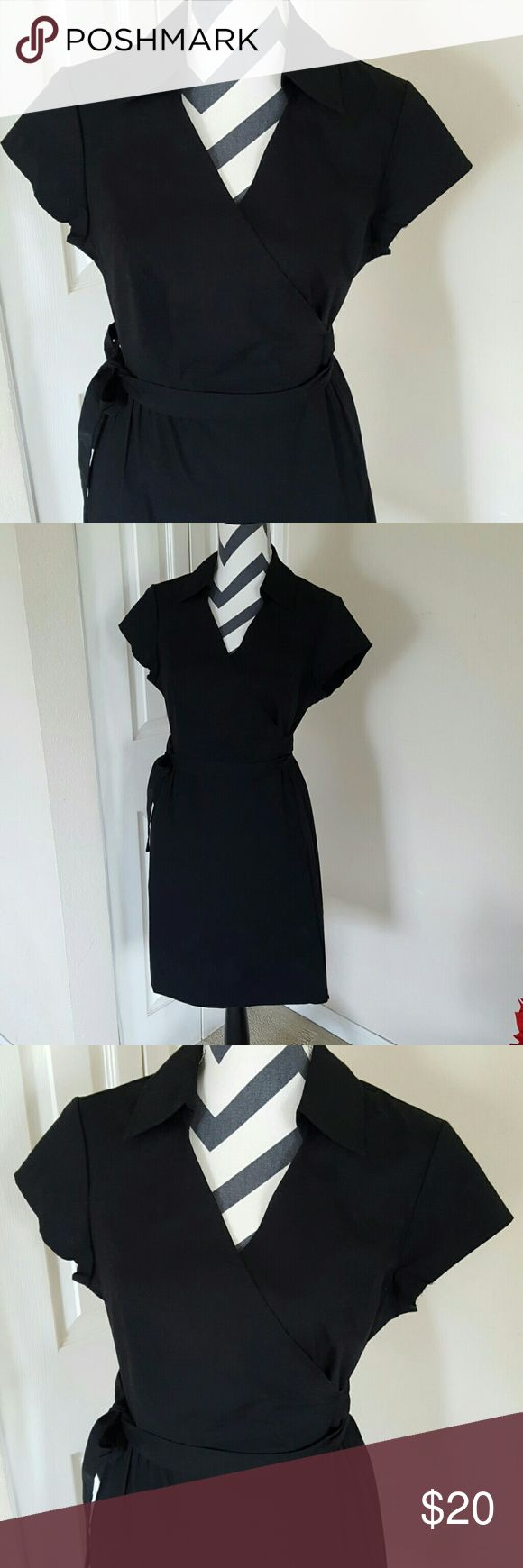 """Black Wrap Dress Brand new, never worn. Has tags 97% cotton, 3% spandex Has a little stretch to it Little bit of dust on a piece of a strap, but might come out in the wash About 18"""" from underarm to underarm About 37"""" from top of shoulder to hem No trades, holds, or Paypal Merona Dresses"""