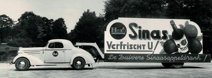 """Hero Conserven is een van oorsprong Zwitsers bedrijf in voedingsmiddelen met fruit als bijlangrijkte ingredient en werd opgericht in jet jaar 1886 in de stad Lenzburg. Op 22 Juli 1914 verbond Hero zijn naam aan een kleine fabriek in Breda dat tot dan toe confiture en vruchtenpulp maakte. Vanaf dat moment ging het """"N.V.Hero Conserven Breda """" heten. In 1933 Hero limonades maken om te kunnen concureren tegen merkloze gazeuses met Hero Perl,Sinas,Frambozen,Grapefruit en Cassis."""