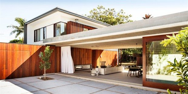 concrete + wood architecture i love the large sliding door that opens up to merge indoor and outdoor