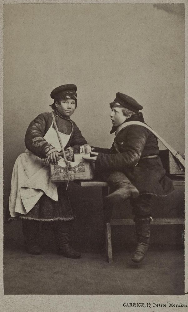 Russian people on photo from 19th century. Boy street vendors with their goods.