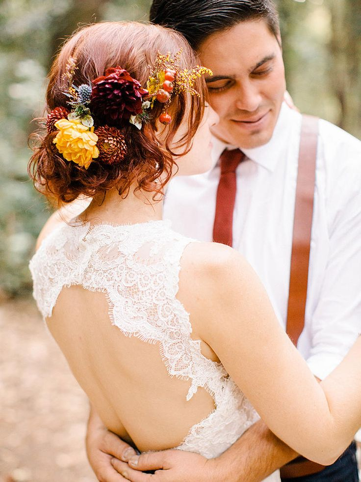 There is no better hair accessory for a backyard or barn wedding than fresh flowers. Pair them with a messy updo for a rustic look.